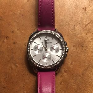 Coach watch with fushcia leather band and crystal.